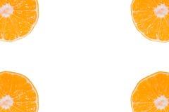 Mandarines enteros y cortados determinados Fotografía de archivo