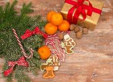 Mandarines, gift box and sweeties Stock Photo