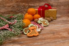 Mandarines, gift box and sweeties Stock Image