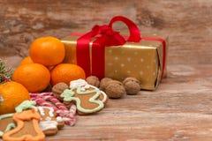 Mandarines, gift box and sweeties Stock Photos