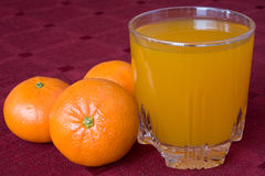 Mandarines and glass of juice Stock Photo