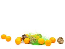 Mandarines and golden balls with green Royalty Free Stock Image