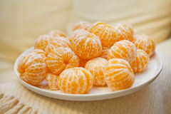 Mandarines. Large plate of pilled mandarines royalty free stock photography