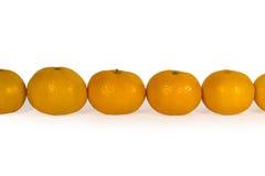Mandarines oranges fraîches d'isolement sur le blanc Photos stock