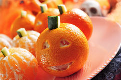 Mandarines ornamented as Halloween pumpkins Royalty Free Stock Images