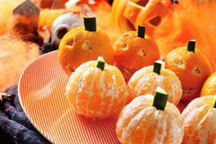 Mandarines ornamented as Halloween pumpkins Royalty Free Stock Photos