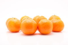 Mandarines på vit bakgrund Arkivbild