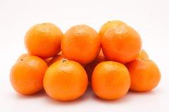 Mandarines på vit bakgrund Arkivbilder