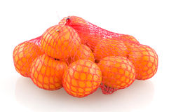 Mandarines in red net. Isolated on white background stock photo