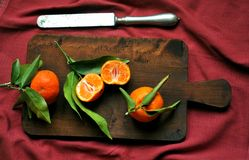 Mandarines still life with a wooden board Royalty Free Stock Image