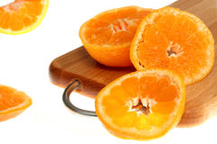 Mandarines sur le blanc Photos stock
