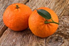 Mandarines Tangerines Fruits on Old Wood Stock Image