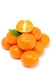 Mandarini isolati su priorità bassa bianca Fotografia Stock