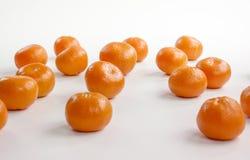 Mandarini su priorità bassa bianca Fotografia Stock