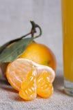 Mandarini su tela di canapa Fotografia Stock