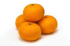 Mandarini su una priorità bassa bianca Immagini Stock Libere da Diritti