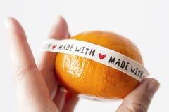 Mandarino con il messaggio di amore fotografie stock