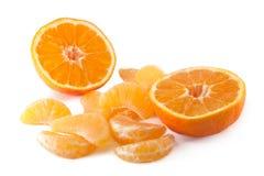 Mandarino e fette sbucciate Fotografia Stock