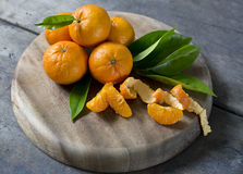 Mandarins. Fresh mandarin with leaves on wooden board royalty free stock images