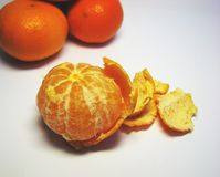 Mandarins 6. Ripe orange mandarins on the grey background Royalty Free Stock Image