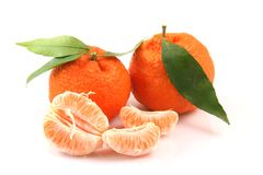 Mandarins And Slices Royalty Free Stock Photography