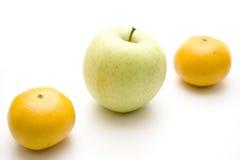 Mandarins and apple Stock Photos