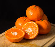 Mandarins on a black background Royalty Free Stock Images