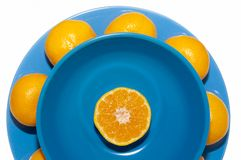 Mandarins on blue plate Stock Photography