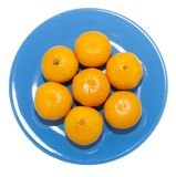 Mandarins on blue plate Royalty Free Stock Photo