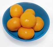 Mandarins on blue plate Royalty Free Stock Image