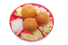 Mandarins and Chinese New Year Delicacies. On White Background stock photo
