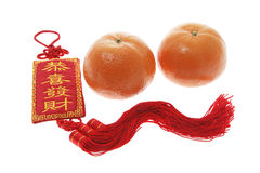 Mandarins and Chinese New Year Trinket Stock Photo