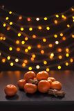 Mandarins and Cinnamon Blurred Defocused Multi Color Lights Background Christmas Royalty Free Stock Photo