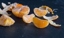 Mandarins and carvings on a dark background royalty free stock photos