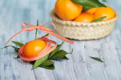 Mandarins in the colored tape Stock Photos