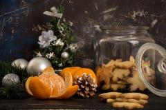 Some snacks for Christmas table. Mandarins and cookies are good snacks for Christmas table Stock Image