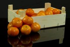 Mandarins in crate Stock Image