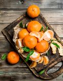 Mandarins on the cutting Board. On wooden background royalty free stock photography
