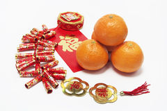 Mandarins and Fire Crackers Royalty Free Stock Image