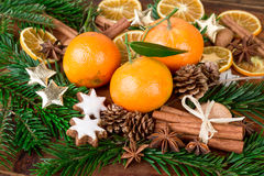 Mandarins fruits with fir branch and christmas spices on wooden table Stock Photo