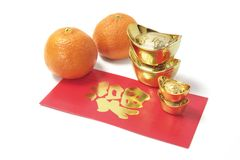 Mandarins, gold Ingots and Red Packet Royalty Free Stock Photos