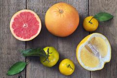 Mandarins and grapefruits. On a wooden table Royalty Free Stock Images