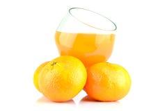 Mandarins and juice Stock Photos