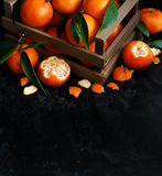 Mandarins with leaves in a box Royalty Free Stock Photo