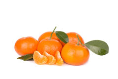 Mandarins with leaves and slices isolated on white. Backround Stock Photo