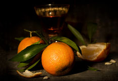 Mandarins and liquor Stock Photos