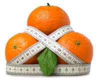Mandarins and measure tape Stock Photography