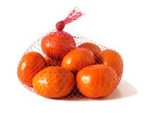 Mandarins in the net bag. On a white background stock photo
