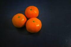 Mandarins oranges. Fresh colorful Mandarins oranges on the Dark Background Royalty Free Stock Photo