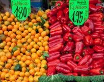 Mandarins and paprika Stock Photography